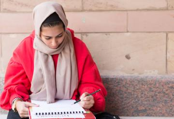 student writing notes