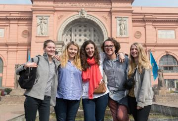 group of students in front of a museum